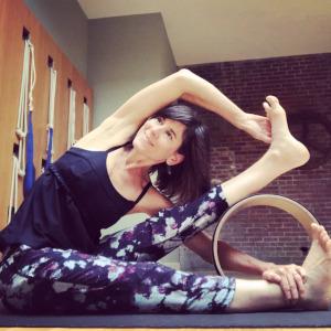 Jennifer Beyt Coffin with yoga wheel